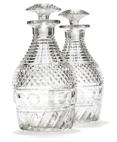 A PAIR OF CUT-GLASS DECANTERS