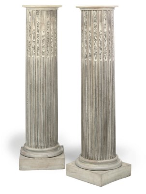 A PAIR OF CARVED LIMED OAK PED