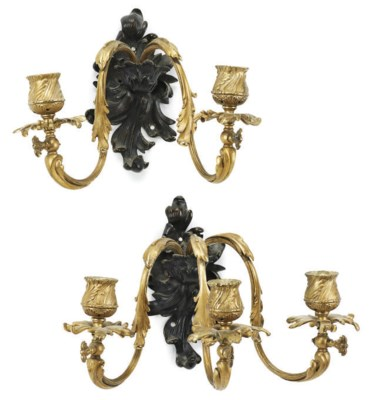 A SET OF SIX GILT AND PATINATE