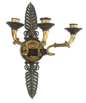 AN EMPIRE GILT AND PATINATED B