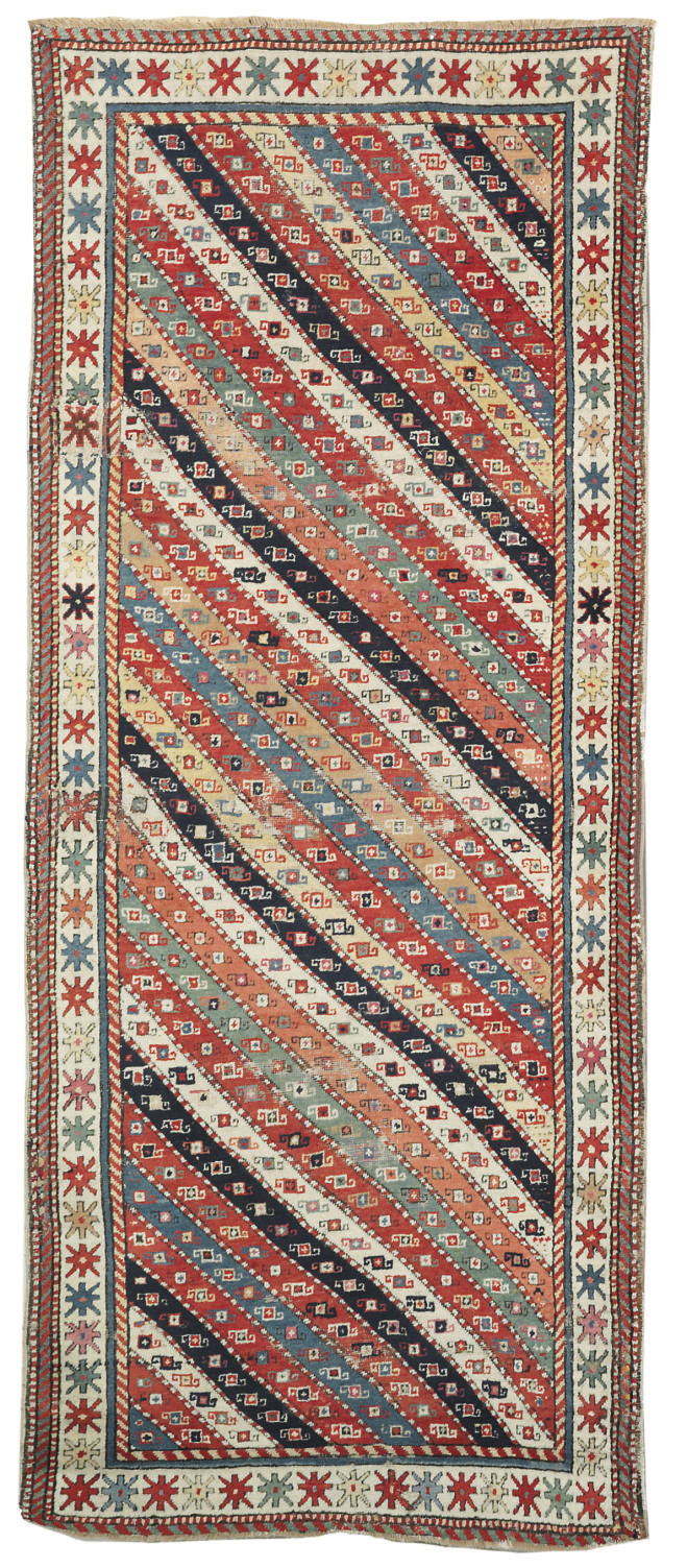 An antique Genje rug & Kazak r