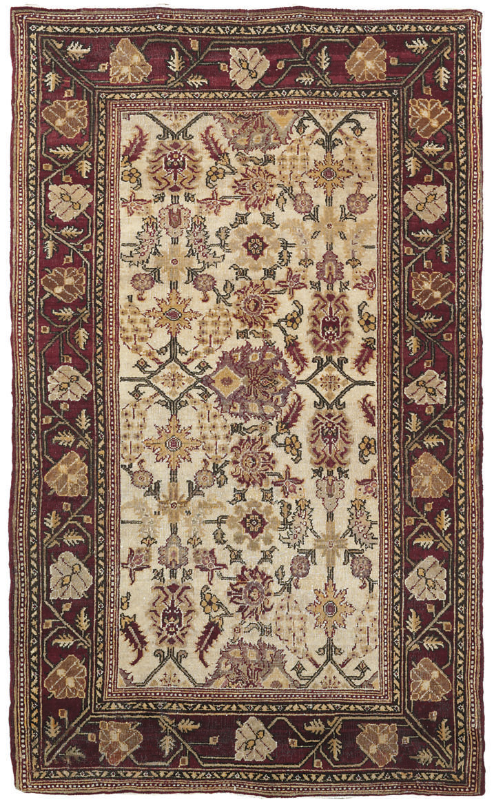 An antique Agra rug & Kula rug