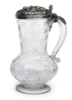 A CUT-GLASS SILVER-MOUNTED TAN