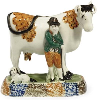 A PRATT WARE MODEL OF A COW AN