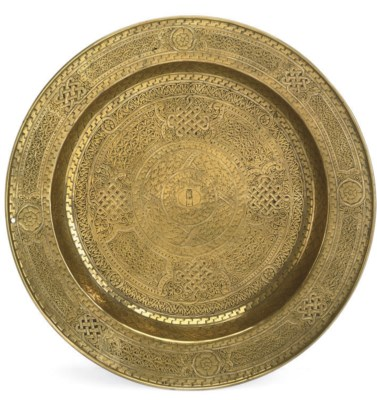 A VENETIAN BRASS AND SILVER IN