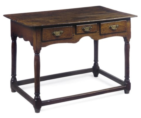 A LARGE OAK SIDE TABLE