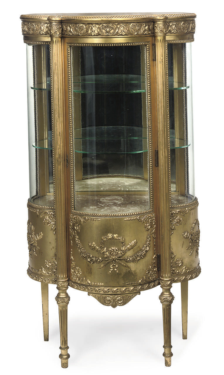 A FRENCH GILT COMPOSTION VITRI