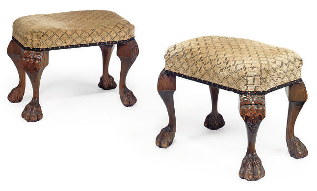 A PAIR OF CARVED WALNUT STOOLS