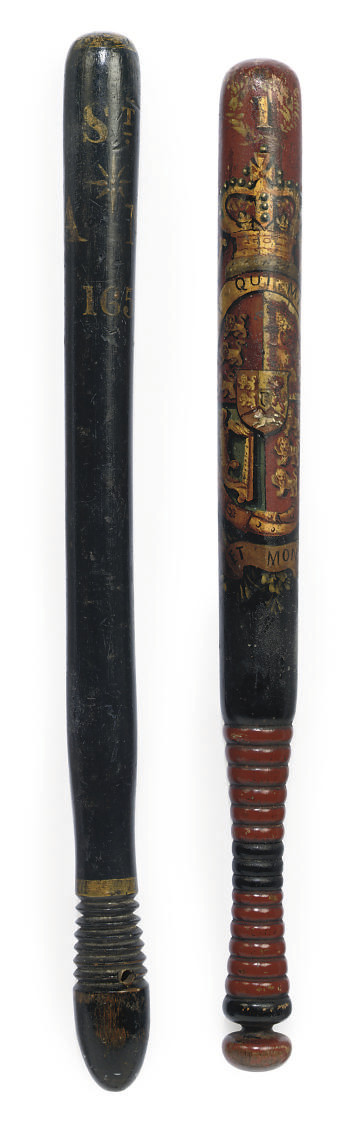 AN EBONISED WOOD TRUNCHEON