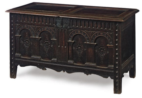 AN ENGLISH CARVED OAK CHEST