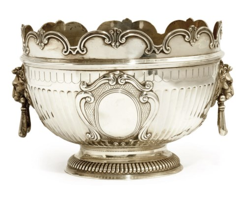 A SILVER PUNCHBOWL IN THE FORM