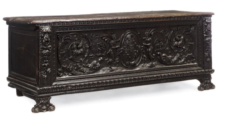 AN ITALIAN CARVED WALNUT CASSO