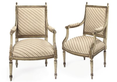 A PAIR OF GILT-HEIGHTENED AND