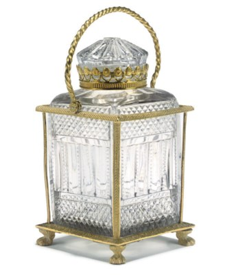 A FRENCH MOULDED-GLASS BOX AND