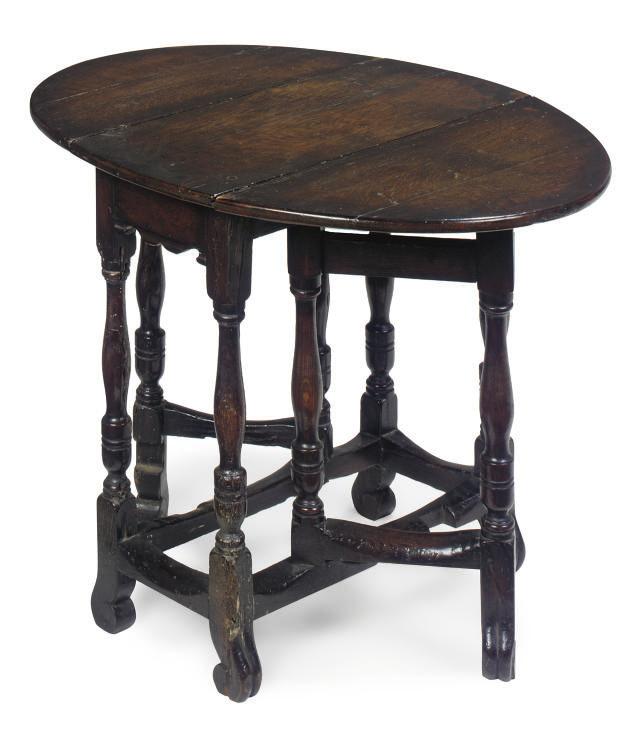 A SMALL OAK GATELEG TABLE
