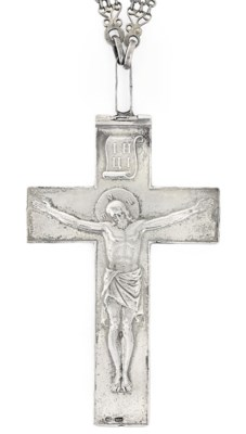 A SILVER PECTORAL CROSS WITH A