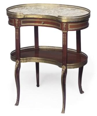 A GILT-METAL MAHOGANY TABLE AM
