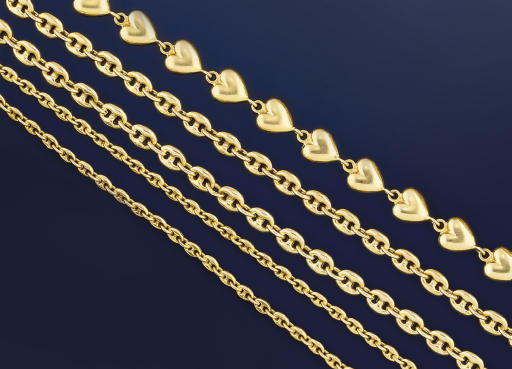 A GROUP OF NECKLACES AND BRACE
