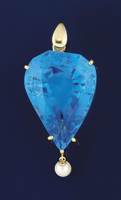 A BLUE TOPAZ AND CULTURED PEAR