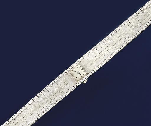 A LADY'S DIAMOND SET WRISTWATC