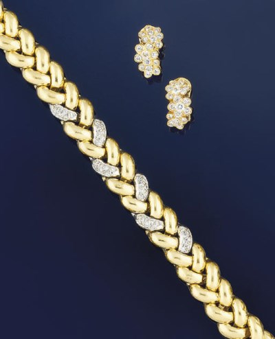 A DIAMOND SET BRACELET AND EAR