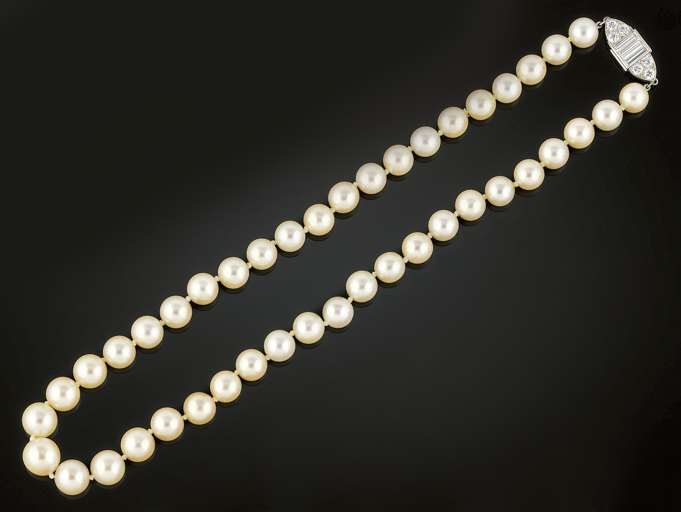 A cultured pearl neckace on a