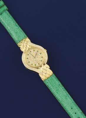 A DIAMOND AND EMERALD SET WRIS