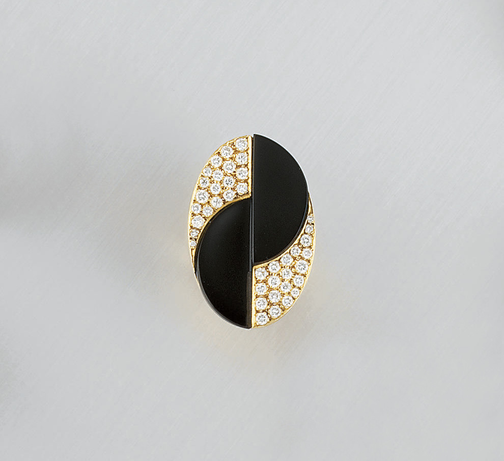 A diamond and onyx ring, by Ti