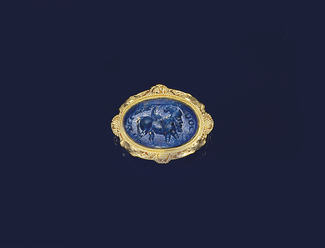 A 19th century archaeological revival gold and lapis lazuli intaglio ring