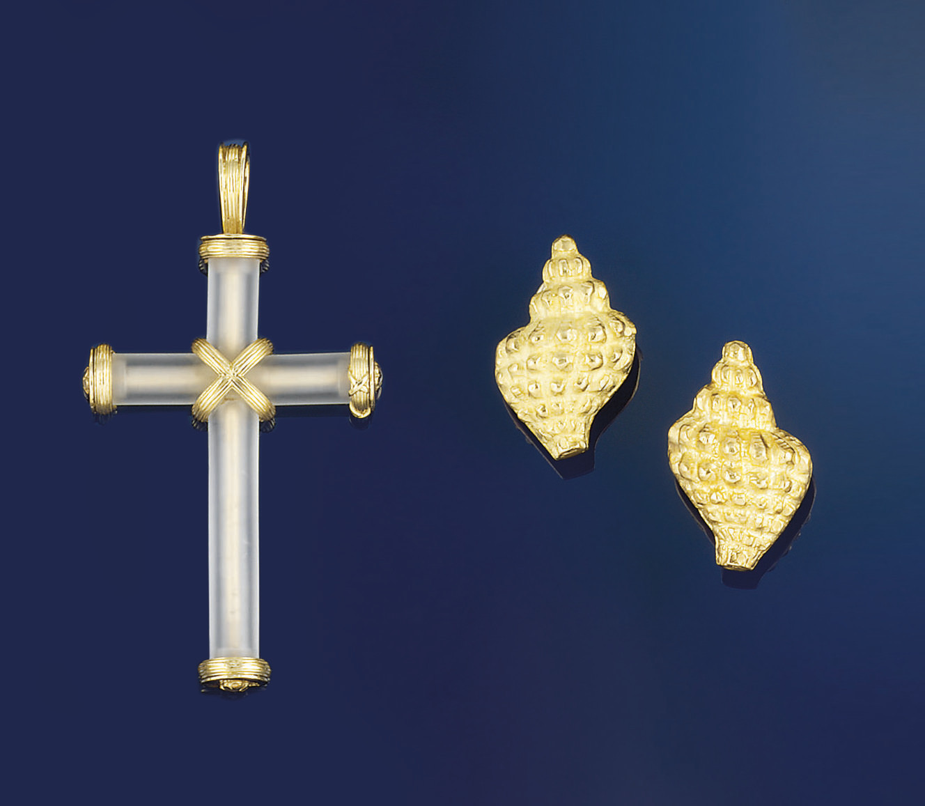 A gold and rock crystal pendant, by Theo Fennell, and a pair of earclips