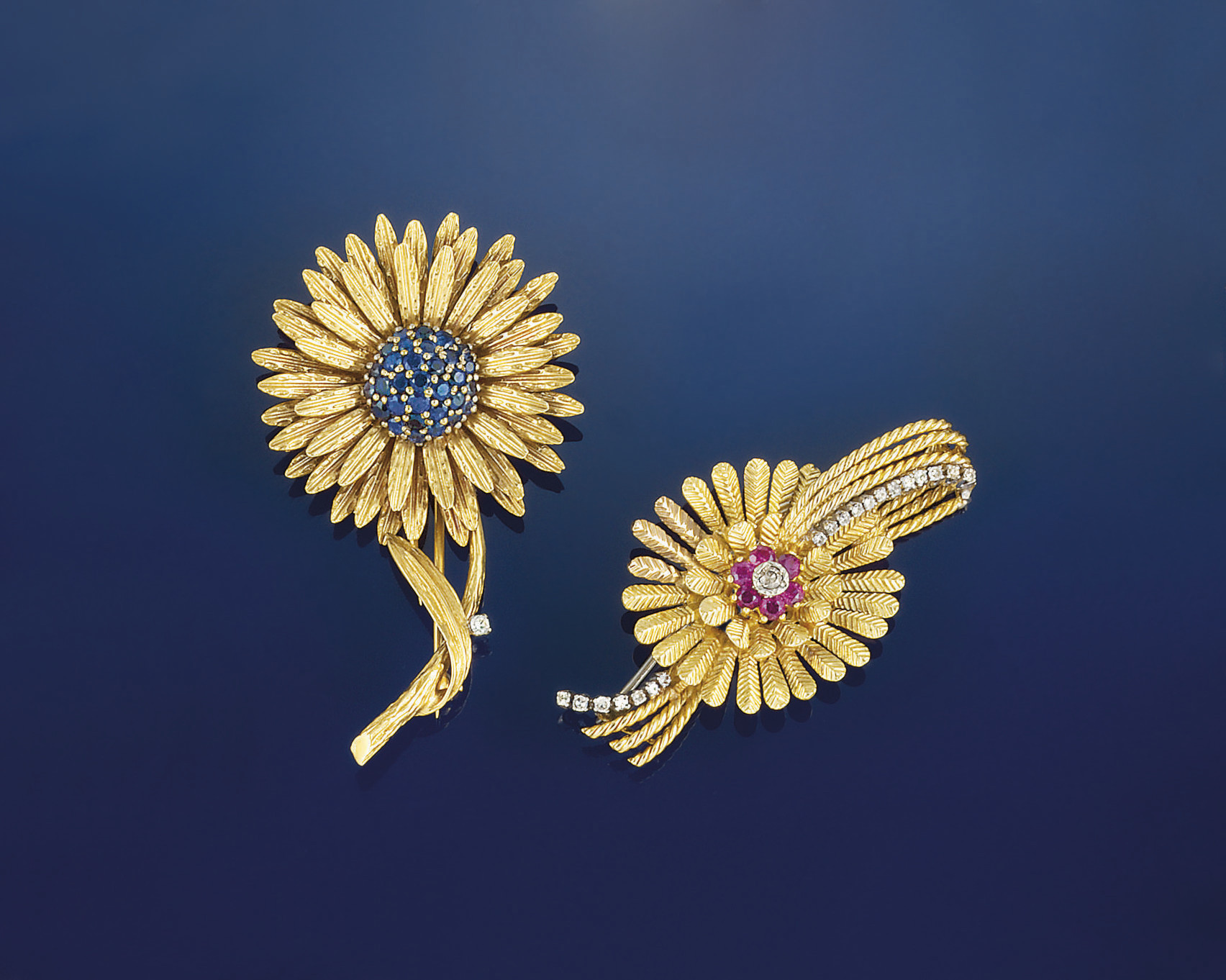 A pair of 18ct. gold and gem b