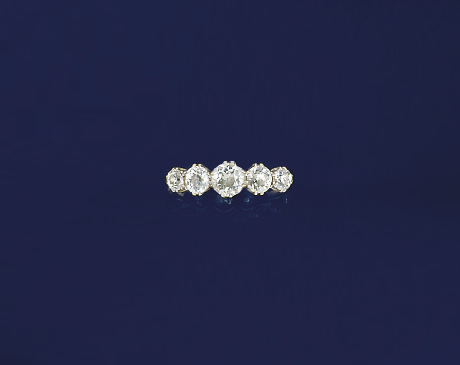 A diamond five stone ring