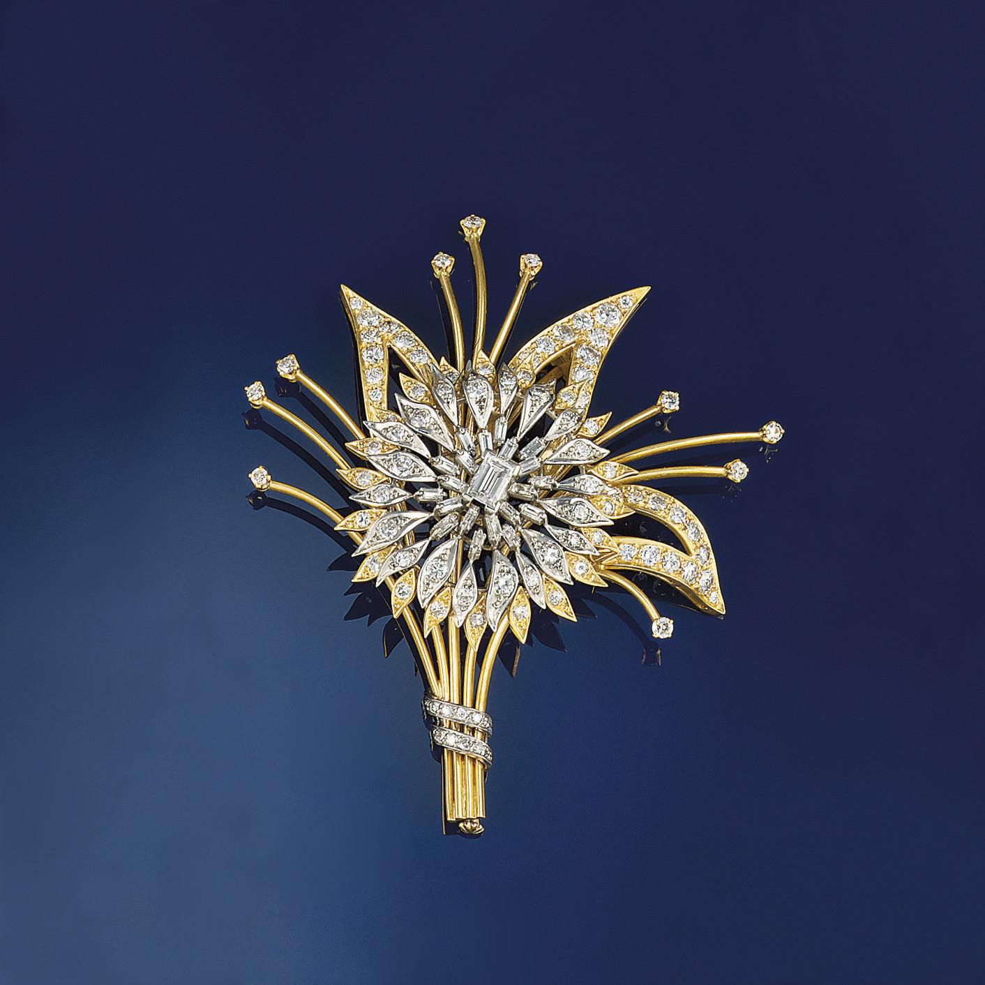 A diamond brooch of floral spr