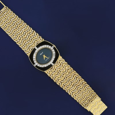 A diamond and onyx set wristwa