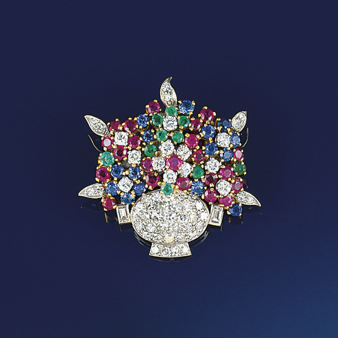 A diamond and gem brooch