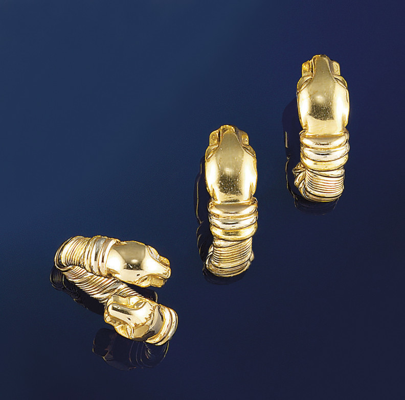A pair of earclips and a ring,