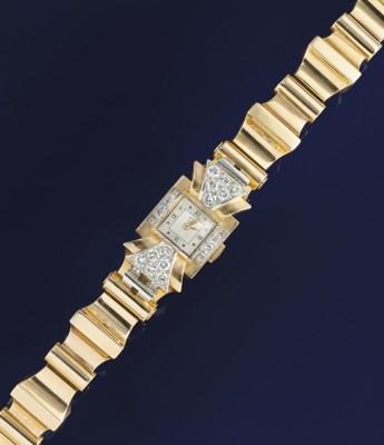 A lady's diamond set gold wris