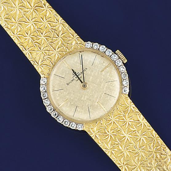 A lady's gold and diamond wris