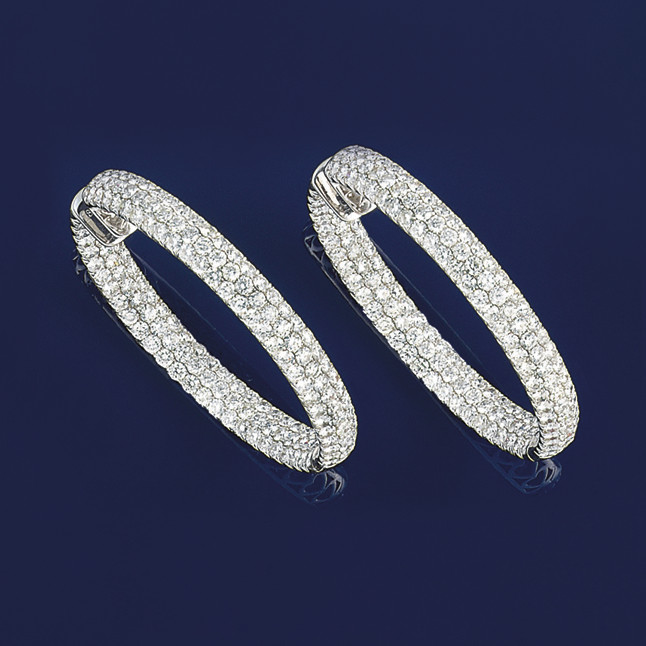 A pair of diamond hoop earring