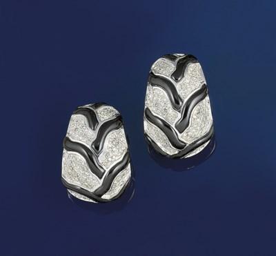 A pair of diamond and onyx ear