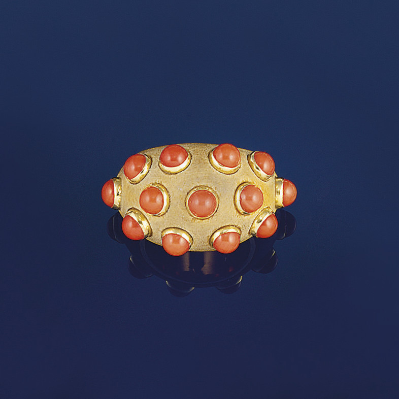 A coral and sandalwood ring, b
