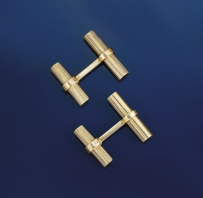A pair of baton cufflinks, by