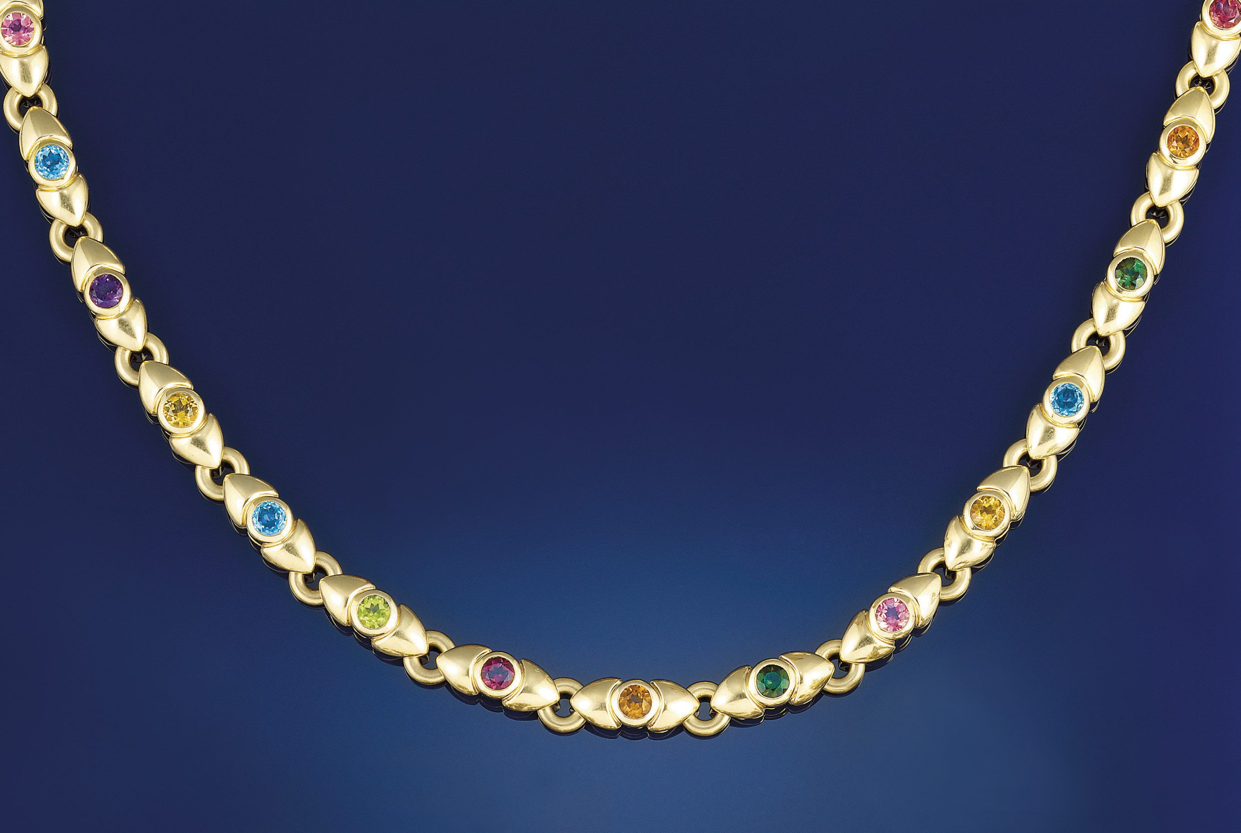 AN 18CT. GOLD AND MULTI GEM NE
