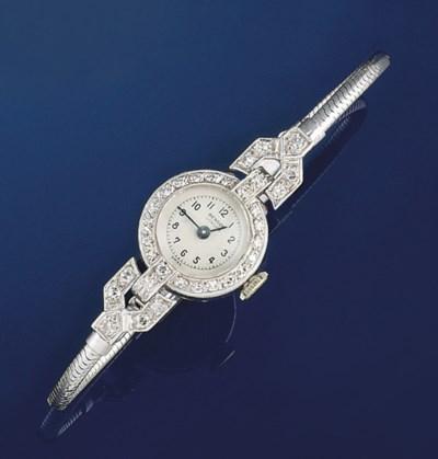 A lady's diamond wristwatch an