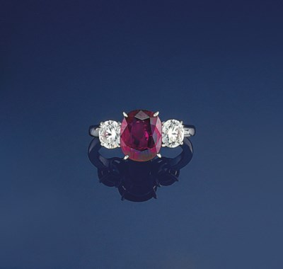 A ruby and diamond three stone