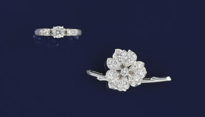 A diamond ring and brooch