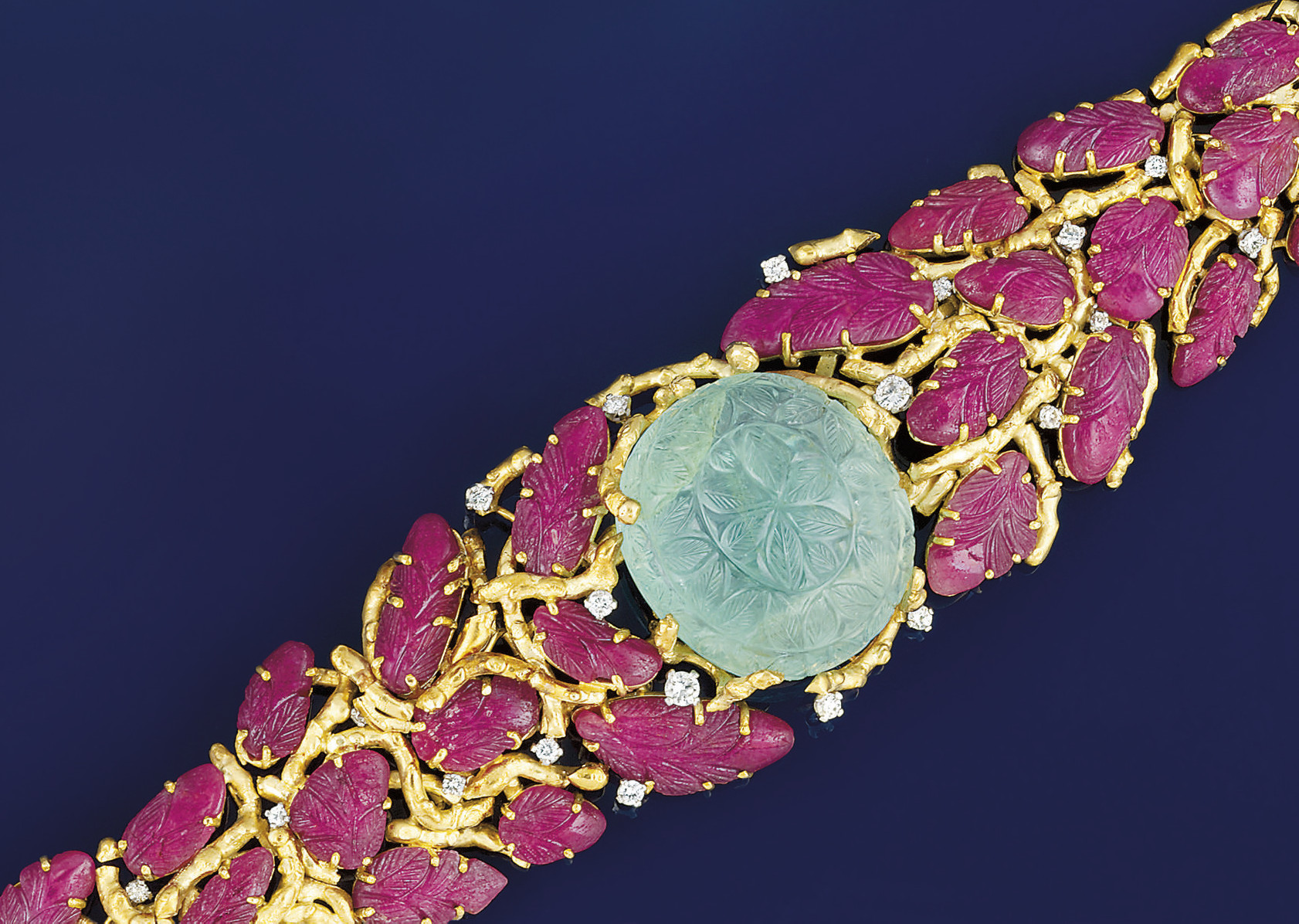 An 18ct. gold, ruby and green beryl bracelet by Grima