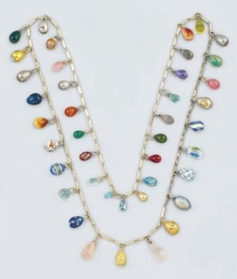A gilt necklace suspending for