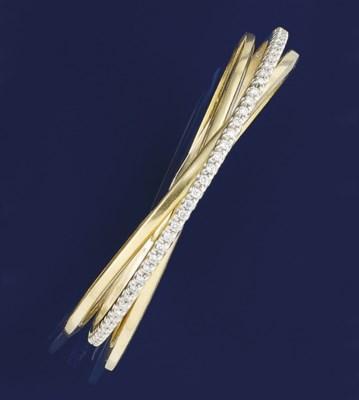 A diamond triple hoop bangle
