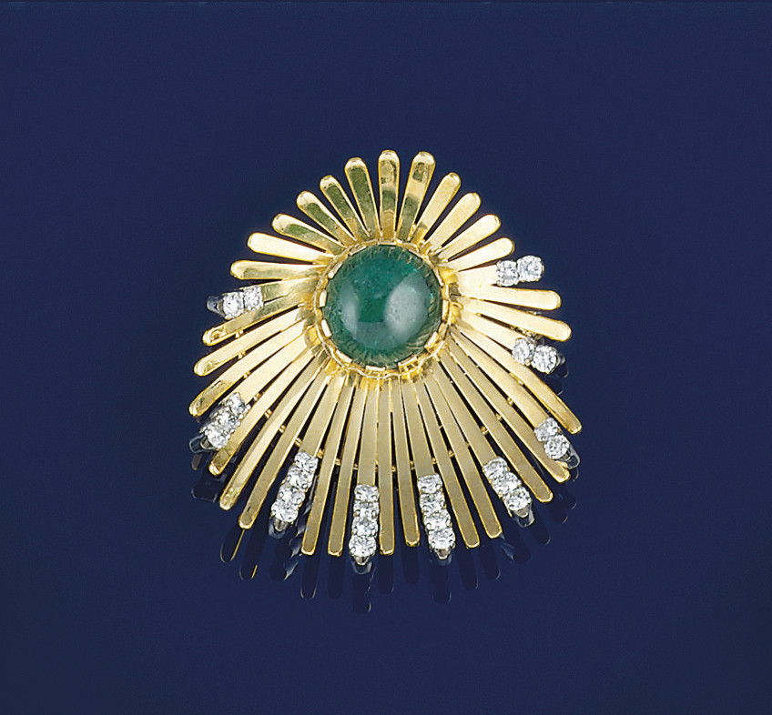 An emerald and diamond brooch/